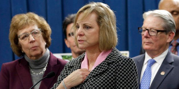 FILE - In this Wednesday, Jan. 21, 2015, file photo, Debbie Ziegler, center, the mother of Brittany Maynard, speaks in suppor
