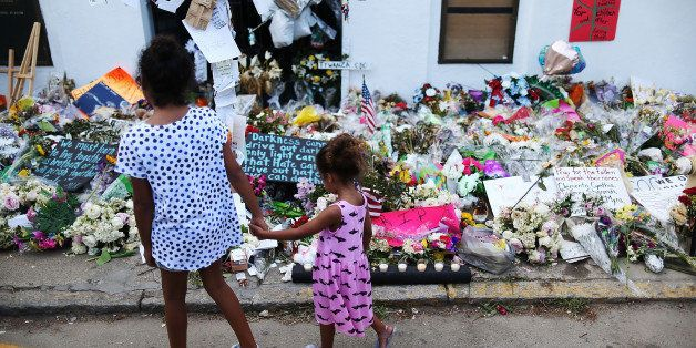 CHARLESTON, SC - JUNE 23:  Children look on at the memorial in front of the Emanuel African Methodist Episcopal Church on Jun