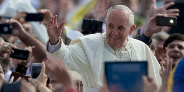 Pope Francis waves to the crowd as he arrives to celebrate a mass in Asuncion, Paraguay, Sunday, July 12, 2015. The pope arri