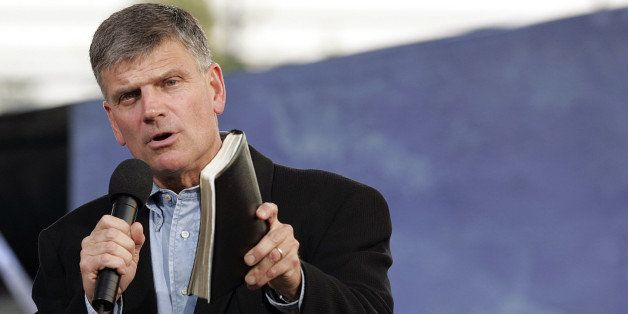 NEW  YORK - JUNE 25:  Franklin Graham, with Bible in hand addresses the crowd before his father Billy Graham speaks during hi