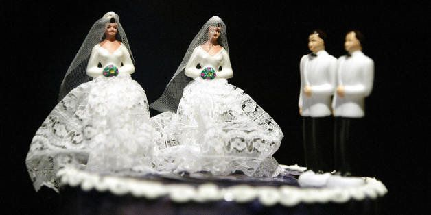 WEST HOLLYWOOD, UNITED STATES:  A wedding cake featuring two grooms and two brides is on display at a local restaurant as par