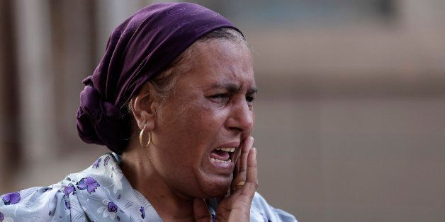 An Egyptian woman mourns over the death of 1st Lt. Mohammed Adel Abdel Azeem, killed in Wednesday's attack by Islamic militan
