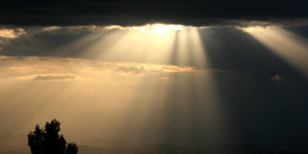 I saw these sunrays, and took this picture, just after visiting the mysterious Churches of Lalibela (Ethiopia), as the night