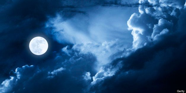 This dramatic photo illustration of a nighttime scene with brightly lit clouds and large, full, Blue Moon would make a great