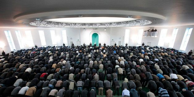Worshippers from the Ahmadiyya Muslim community attend Friday prayers at the Baitul Futuh Mosque in south London, Friday, Feb