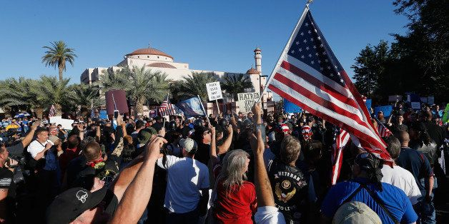 PHOENIX, AZ - MAY 29:  Protesters and counter-protesters rally outside the Islamic Community Center on May 29, 2015 in Phoeni