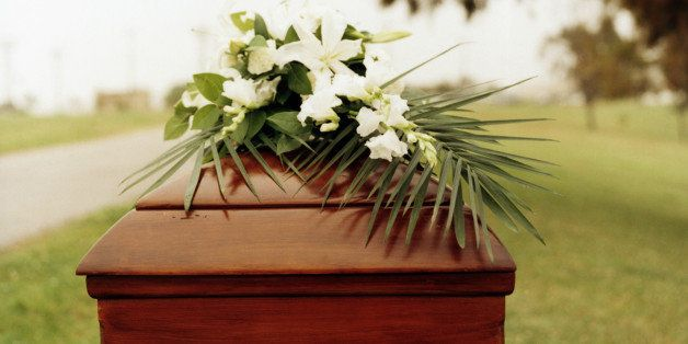 Funerary flowers over coffin