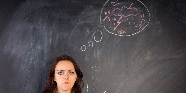 Angry young woman glaring at the camera in a depiction of rage as shown by the hand-drawn diagram of a bolt of lightning and