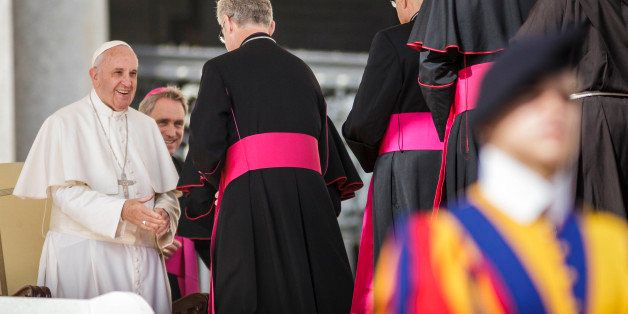 VATICAN CITY, VATICAN - 2015/10/07: Pope Francis greets bishops during his weekly General Audience in St. Peters Square in Va