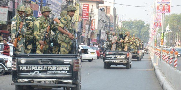 AMRITSAR, INDIA - OCTOBER 20:  Border Security Force (BSF ) jawans and Punjab Police Jawans performing in the flag march afte