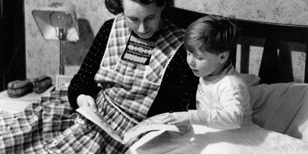 30th January 1954:  Scotland's youngest film star Vincent Winter is ready for bed and Mum tells him a story. Original Publica