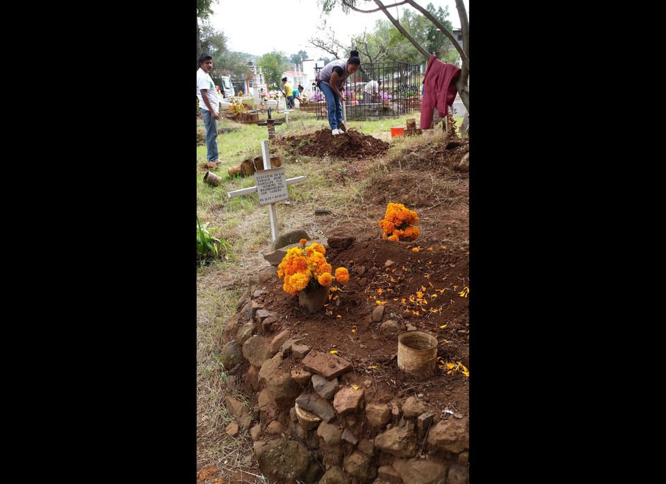 Residents of Tzintzuntzan, Michoacan, prepare the graves of family members for Day of the Dead.