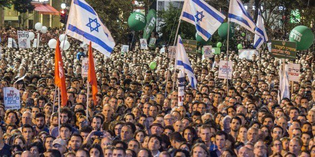 A general view shows people attending a commemorative rally in memory of late Israeli prime minister Yitzhak Rabin, at Rabin