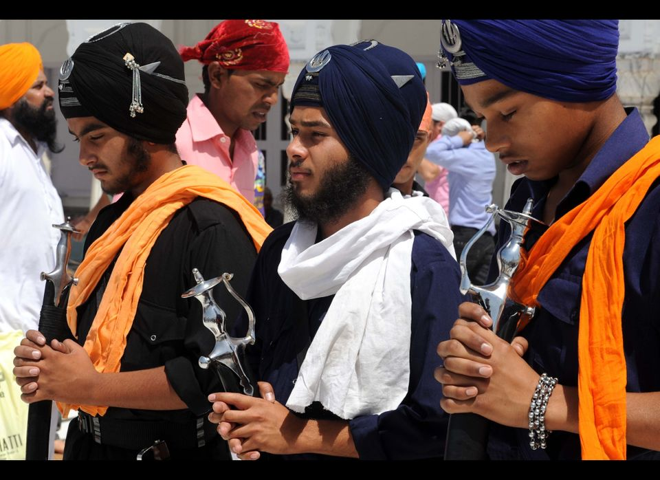 Young Sikh Nihang Army warriors pay their respects at the Sikh Shrine the Golden temple in Amritsar on April 13, 2010.