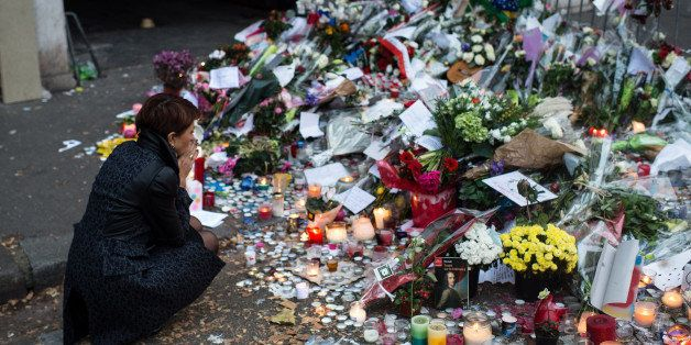PARIS, FRANCE - NOVEMBER 16:  A woman mourns the victims near the Bataclan concert hall on November 16, 2015 in Paris, France