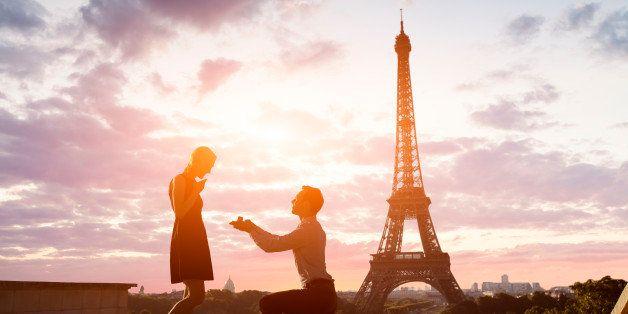 Romantic marriage proposal at Eiffel Tower, Paris, France