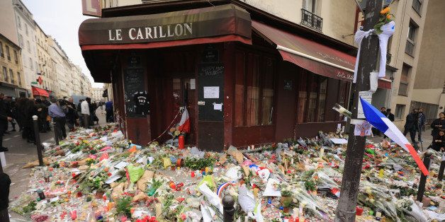PARIS, FRANCE - NOVEMBER 16:  A general view of the tributes outside the Le Carillon restaurant, one of the scenes of last fr