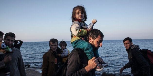 SKALA SIKAMINIAS, GREECE - NOVEMBER 05:  Refugees from Afghanistan and Syria arrive in boats on the shores of Lesbos on Novem