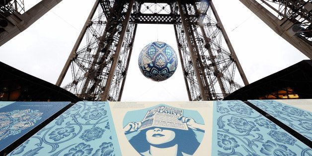 American street artist Shepard Fairey, aka Obey, 's latest piece 'Earth Crisis', a giant sphere themed on environment hangs b