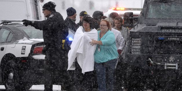 COLORADO SPRINGS, CO - NOVEMBER 27: People are rescued near the scene of a shooting at the Planned Parenthood clinic in Color