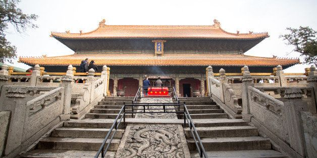 QUFU, SHANDONG PROVINCE, CHINA - 2015/03/19: Dragon carved stone steps leading to Dacheng Hall, also called the Hall of Great