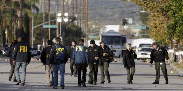 SAN BERNARDINO, CA  - DECEMBER 3: Law enforcement personnel continue to investigate on San Bernardino Avenue, where two suspe