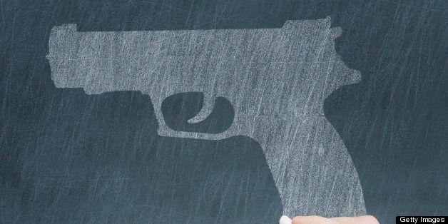 concept on a chalkboard: crime in school, school shooting, massacre ...