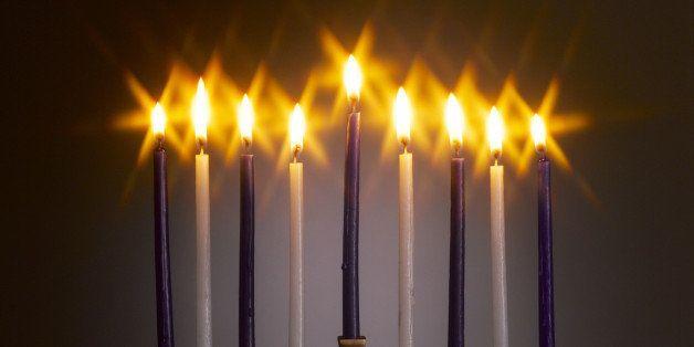 Menorah with lit candles, studio shot
