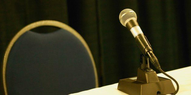 Empty chair and table with microphone