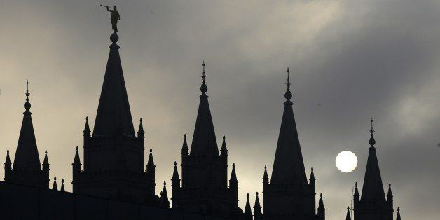 FILE - In this Feb. 6, 2013, file photo, the angel Moroni statue, silhouetted against a cloud-covered sky, sits atop the Salt