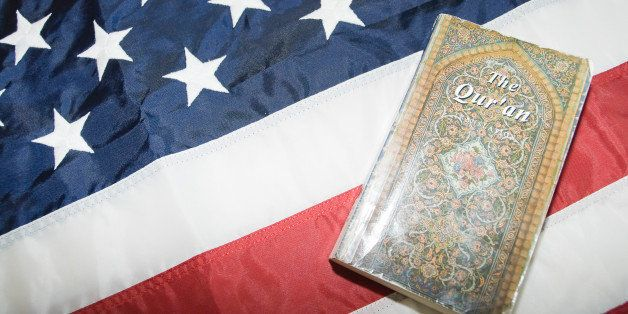 Close-up of Holy Quran on American flag.