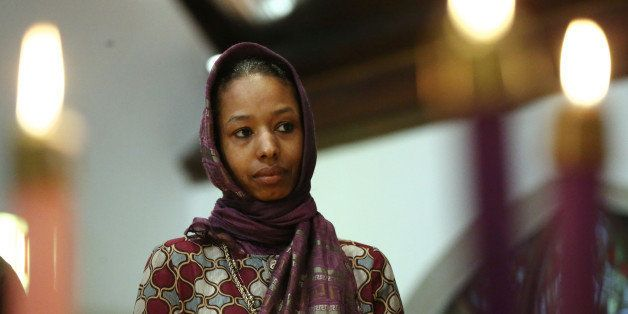 Larycia Hawkins, a Christian who is wearing a hijab over Advent in solidarity with Muslims, attends service at St. Martin Epi