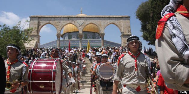 Palestinian scouts take part in celebrations marking the Muslim holiday 'Israa and Miraj', the day on which, according to tra