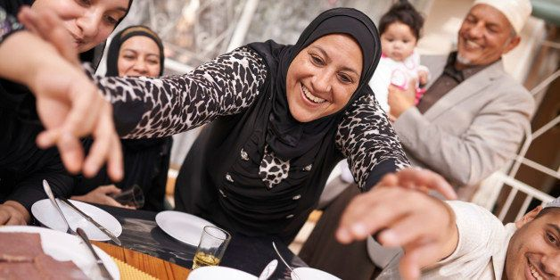 Shot of a muslim family eating together