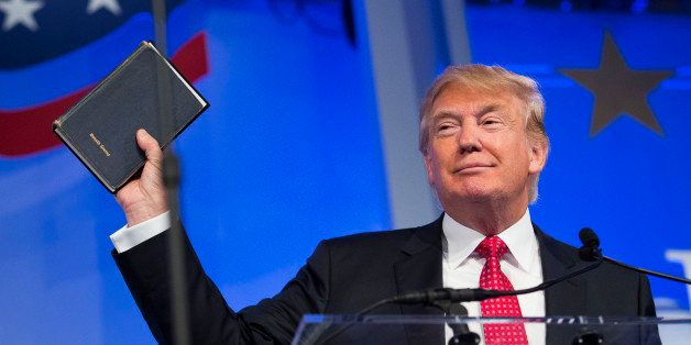 Donald Trump, president and chief executive of Trump Organization Inc. and 2016 Republican presidential candidate, holds up a Bible while speaking at the Values Voter Summit in Washington, D.C., U.S., on Friday, Sept. 25, 2015. The annual event, organized by the Family Research Council, gives presidential contenders a chance to address a conservative Christian audience in the crowded Republican primary contest. Photographer: Drew Angerer/Bloomberg via Getty Images