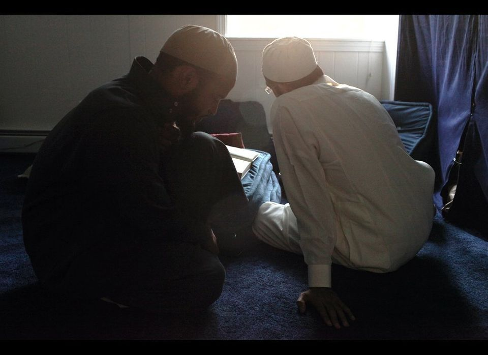 Day 2: Two young men take turns reciting verses they have memorized from the Quran. Both were brought from a special Islamic