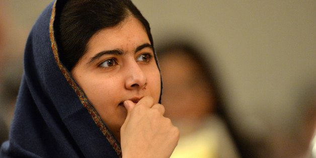 Pakistani activist for female education and Nobel Peace Prize laureate Malala Yousafzai listens to speakers at an event to co
