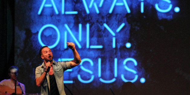 In this July 14, 2013 photo, Pastor Carl Lentz, foreground, leads a Hillsong NYC Church service at Irving Plaza in New York.