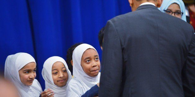 Girls wait for their chance to greet US President Barack Obama at the Islamic Society of Baltimore, in Windsor Mill, Maryland