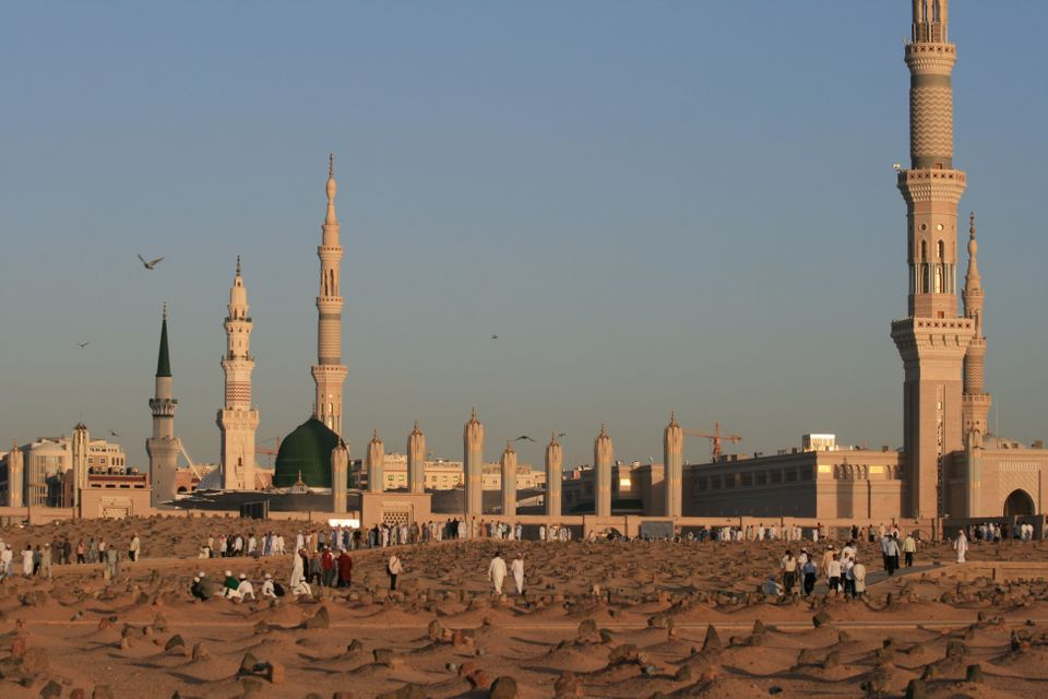"""The Medina graveyard, dubbed the """"Garden of Heaven,"""" in the foreground and the Prophet's Mosque in the background."""