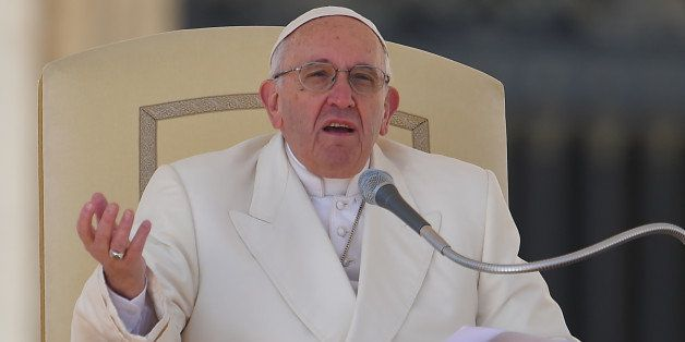 Pope Francis addresses the crowd during his weekly general audience at St Peter's square on March 2, 2016 at the Vatican. / A