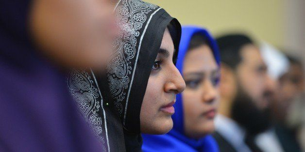 Women watch as US President Barack Obama speaks at the Islamic Society of Baltimore, in Windsor Mill, Maryland on February 3,