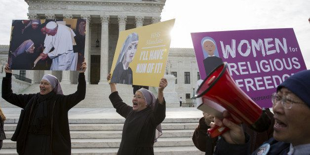 Nuns, who are opposed to the Affordable Care Act's contraception mandate, rally outside of the Supreme Court in Washington, D