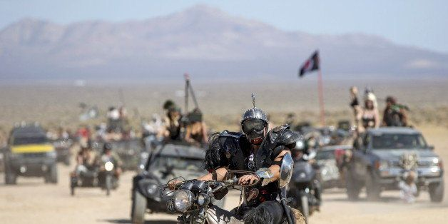 An enthusiast rides his customized motorcycle during the Wasteland Weekend event in California City, California September 26,