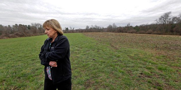 In this April 12, 2016 photo, Desiree Moninski, walks on land located across from her house in Dudley, Mass., which is the si