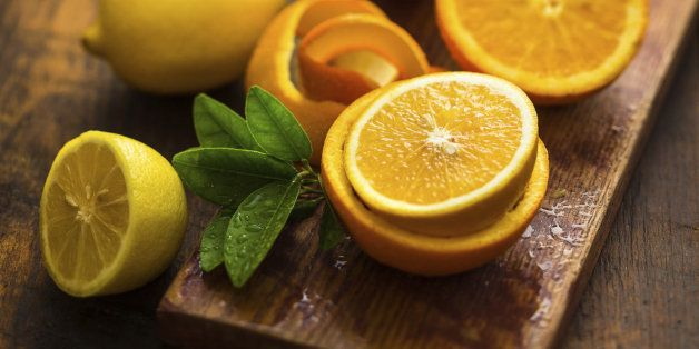 oranges and lemons over a wooden background