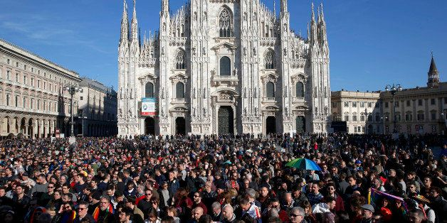 People gather in front of Milan's Duomo cathedral during a gay rights demonstration prior to a vote at the Italian parliament