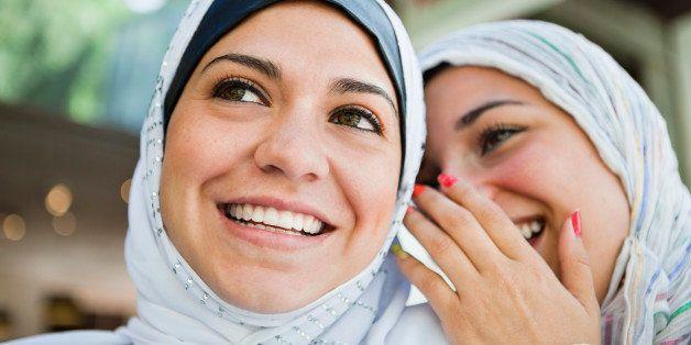Two women whispering