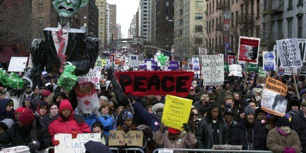 UNITED STATES - FEBRUARY 15:  A sea of protesters, and one enormous papier-mache effigy of President Bush, fills First Ave. a