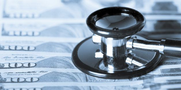 Stethoscope and $100 dollar bills symbolizing healthcare spending and the affordable care act